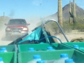 Long drives on dirt roads with trucks full of water, to save lives in remote AZ desert