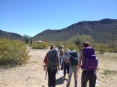 hiking the last miles from the road with packs full of water and supplies